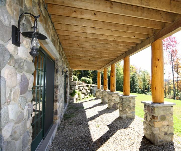 Log cabin deck posts stone foundation