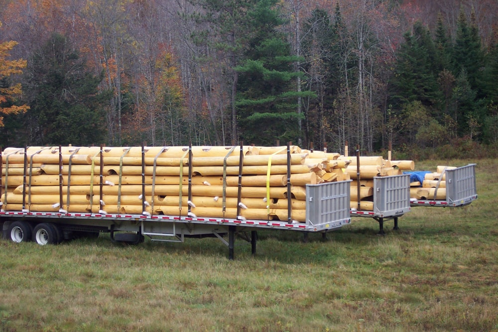 Scribed logs loaded on trailer for transport