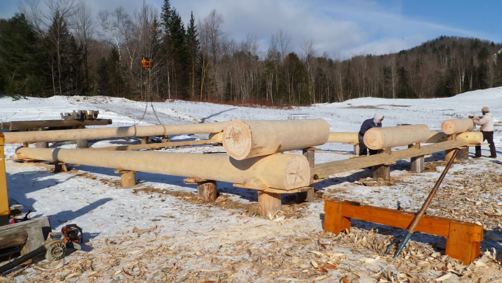 Logs placed for log cabin builders to scribe fit