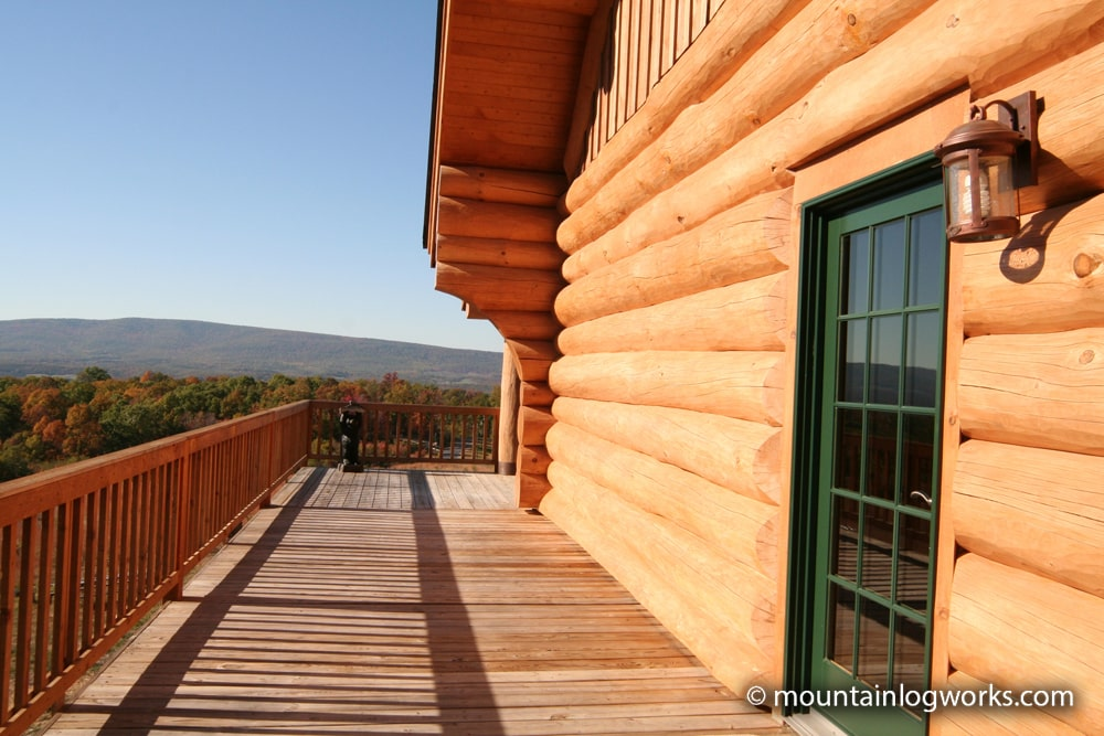 Custom log cabin deck with mountain view