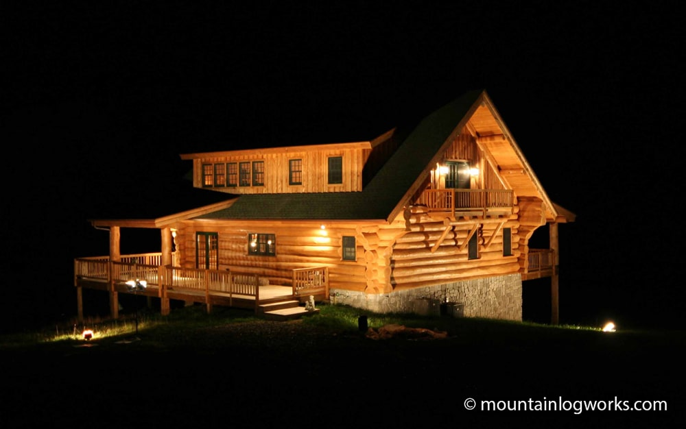 log cabin home at night