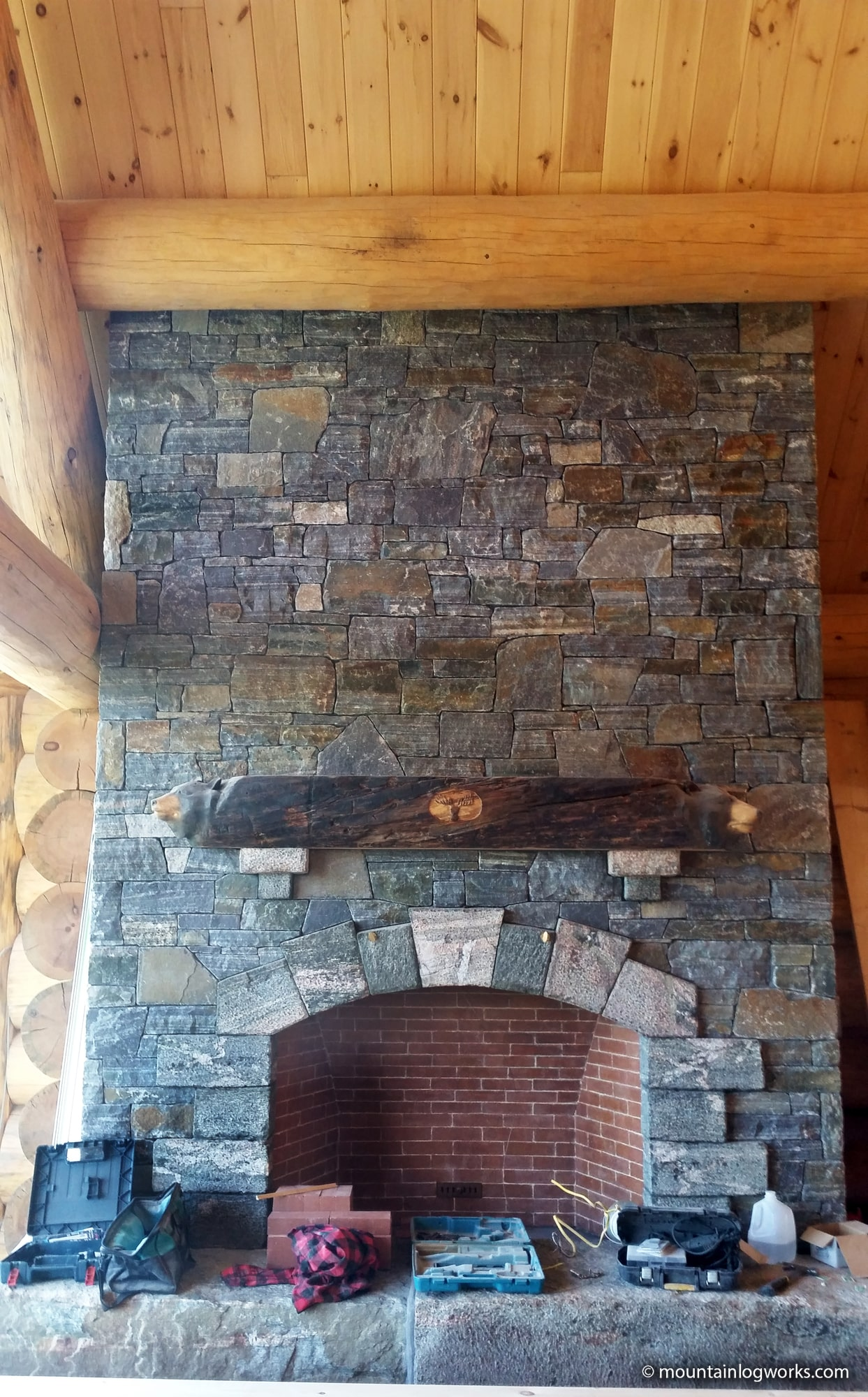 Granite fireplace in log cabin home