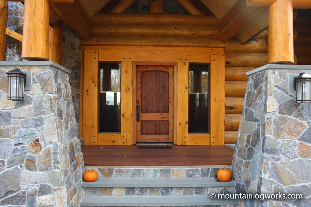 Log cabin timber frame entry with stone steps