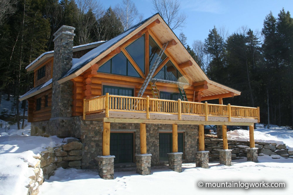 Log home with large glass windows in the sun