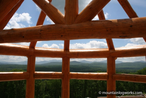 Custom log cabin timber frame with mountain view
