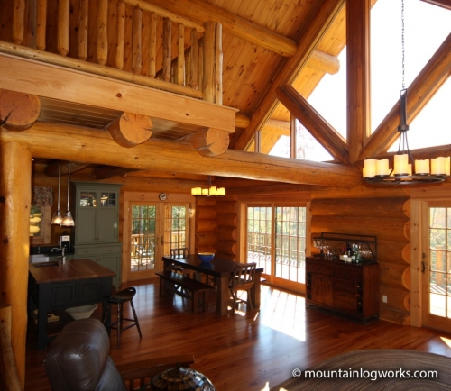 Cathedral Ceiling cozy log cabin living room